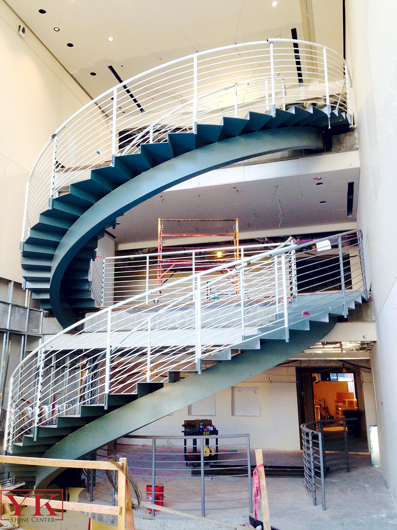 Antero resources spiral stair case, union one station stair case, stone in antero resoures spiral stair case in denver
