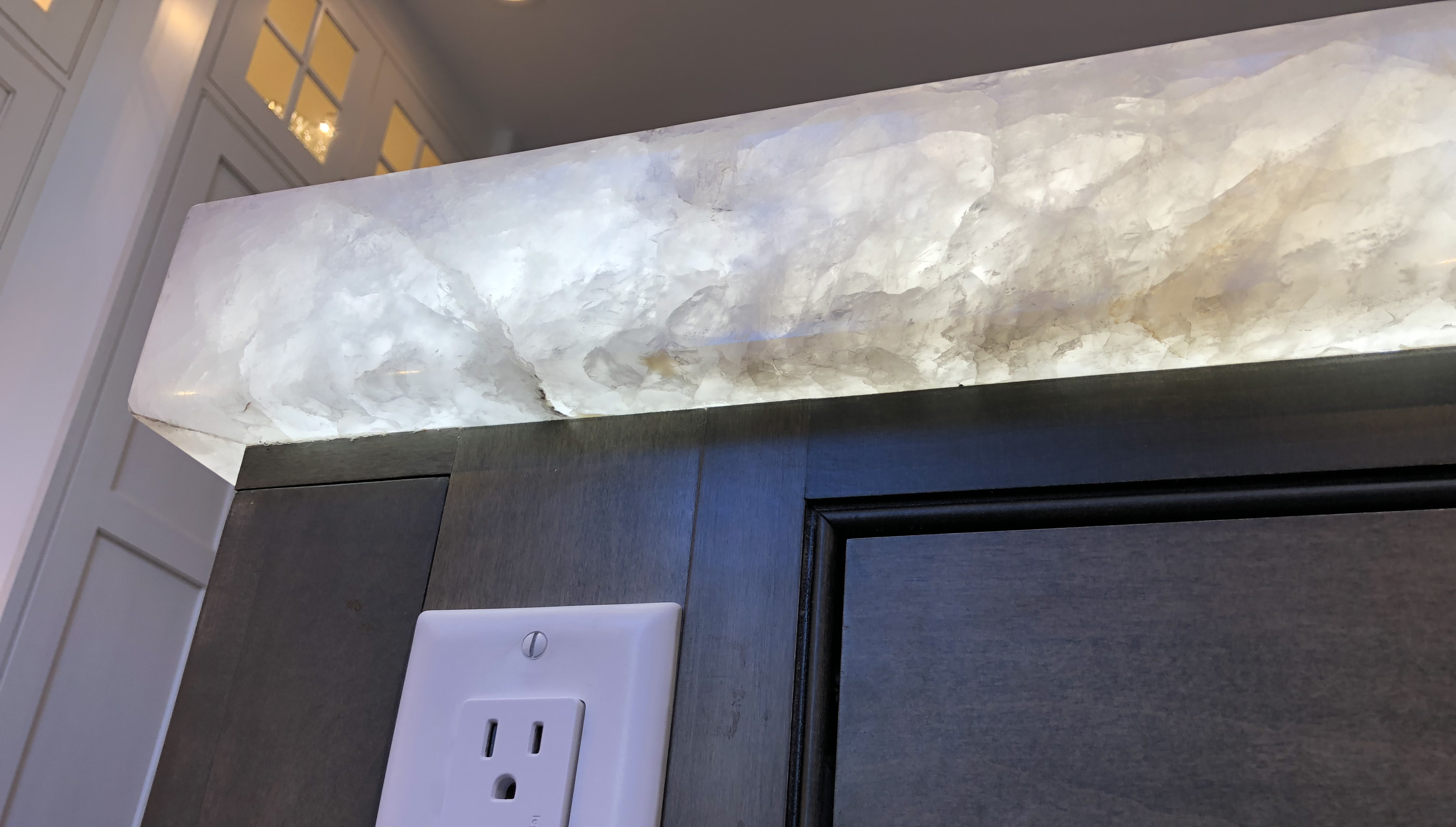 LED under countertop pannel. quartz glowing, kitchen countertop
