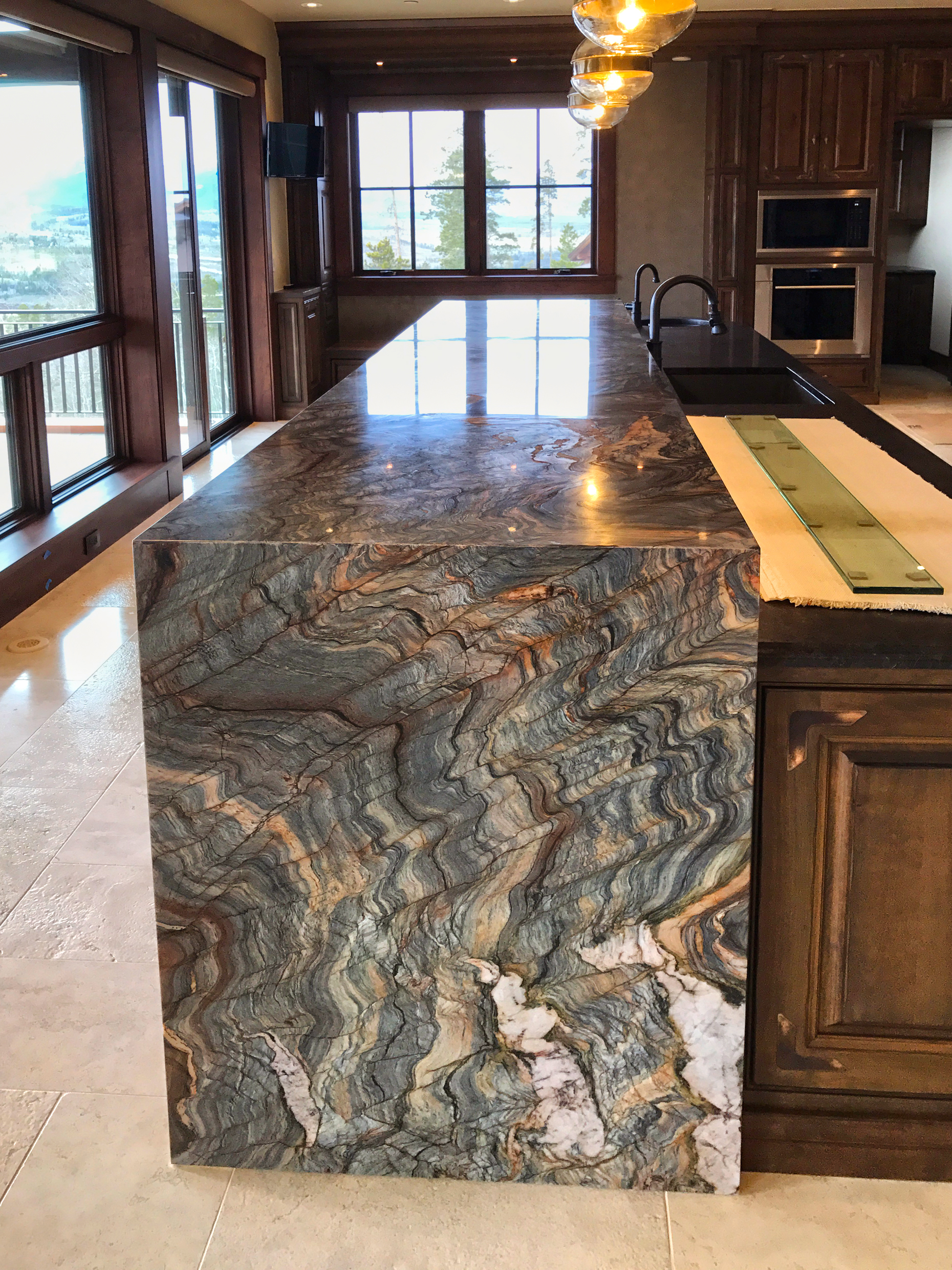 Fusion Granite itchen island. 6cm Mitred waterfall edges. 6cm mirrored flat polish edge. 6cm Laminate waterfall side panels. YK Stone Center Installed